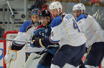 DENVER - NOVEMBER 15:  Goalie Jaroslav Halak #41 of the St. Louis Blues defends the goal as Daniel Winnik #34 of the Colorado Avalanche, Eric Brewer #4 and Erik Johnson #6 of the Blues keep their eyes on the puck at the Pepsi Center on November 15, 2010 i