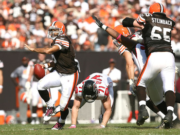 CLEVELAND - OCTOBER 10:  Quarterback Seneca Wallace #6 of the Cleveland Browns gets a block from Eric Steinbach #65 as he runs from defender Kroy Biermann #71 of the Atlanta Falcons at Cleveland Browns Stadium on October 10, 2010 in Cleveland, Ohio.  (Pho