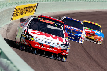HOMESTEAD, FL - NOVEMBER 21:  Greg Biffle, driver of the #16 3M Ford, leads a group of cars during the NASCAR Sprint Cup Series Ford 400 at Homestead-Miami Speedway on November 21, 2010 in Homestead, Florida.  (Photo by Sam Greenwood/Getty Images)