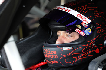 HOMESTEAD, FL - NOVEMBER 20:  Tony Stewart, driver of the #14 Old Spice/Office Depot Chevrolet, sits in his car during practice for the NASCAR Sprint Cup Series Ford 400 at Homestead-Miami Speedway on November 20, 2010 in Homestead, Florida.  (Photo by Jo