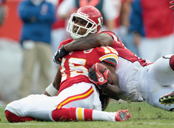 KANSAS CITY, MO - NOVEMBER 21:  Verran Tucker #15 of the Kansas City Chiefs is pulled down during the game against the Arizona Cardinals at Arrowhead Stadium on November 21, 2010 in Kansas City, Missouri.  (Photo by Jamie Squire/Getty Images)