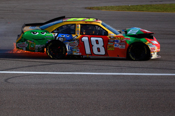 HOMESTEAD, FL - NOVEMBER 21:  Kyle Busch, driver of the #18 M&M'sToyota, drives with his car on fire after crashing during the NASCAR Sprint Cup Series Ford 400 at Homestead-Miami Speedway on November 21, 2010 in Homestead, Florida.  (Photo by Chris Grayt
