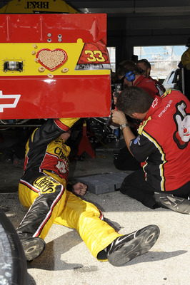 HOMESTEAD, FL - NOVEMBER 20:  Clint Bowyer (L), driver of the #33 Cheerios Chevrolet, works on his car with a crew member during practice for the NASCAR Sprint Cup Series Ford 400 at Homestead-Miami Speedway on November 20, 2010 in Homestead, Florida.  (P