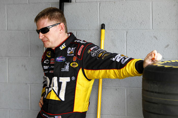 HOMESTEAD, FL - NOVEMBER 20:  Jeff Burton, driver of the #31 Caterpilliar Chevrolet, stands in the garage during practice for the NASCAR Sprint Cup Series Ford 400 at Homestead-Miami Speedway on November 20, 2010 in Homestead, Florida.  (Photo by Chris Tr