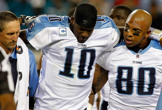JACKSONVILLE, FL - OCTOBER 18:  Quarterback Vince Young #10 of the Tennessee Titans is helped from the field during the first quarter against the Jacksonville Jaguars during the game at EverBank Field on October 18, 2010 in Jacksonville, Florida.  (Photo