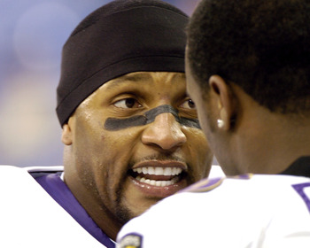 Baltimore Ravens linebacker Ray Lewis motivates his teammates against the Indianapolis Colts  in the RCA Dome Dec. 19, 2004.  The Colts defeated the Ravens 20 to 10.  (Photo by Al Messerschmidt/Getty Images)