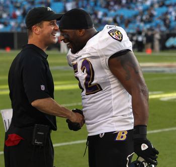CHARLOTTE, NC - NOVEMBER 21:  Head coach John Harbaugh and Ray Lewis #52 of the Baltimore Ravens shake hands after defeating the Carolina Panthers 37-13 at Bank of America Stadium on November 21, 2010 in Charlotte, North Carolina.  (Photo by Streeter Leck
