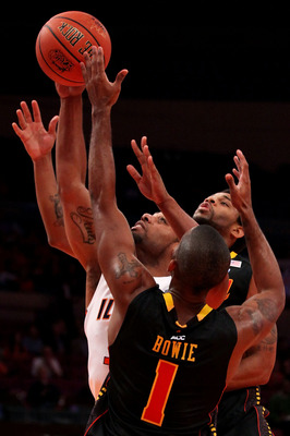 NEW YORK - NOVEMBER 19:  Demetri McCamey #32 of the Illinois Fighting Illini grabs a rebound under pressure from Adrian Bowie #1 of the Maryland Terrapins during the 2k Sports Classic at Madison Square Garden on November 19, 2010 in New York, New York.  (