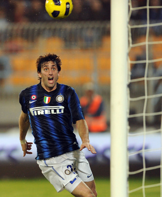 LECCE, ITALY - NOVEMBER 10:  Diego Milito of Inter Milan scores the opening goal during the Serie A match between Lecce and Inter Milan at Stadio Via del Mare on November 10, 2010 in Lecce, Italy.  (Photo by Giuseppe Bellini/Getty Images)