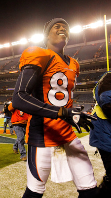 DENVER - NOVEMBER 14:  Wide receiver Brandon Lloyd #84 of the Denver Broncos celebrates the Broncos 49-29 win over the Kansas City Chiefs as he leaves the field at INVESCO Field at Mile High on November 14, 2010 in Denver, Colorado. (Photo by Justin Edmon