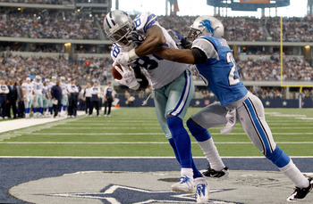 ARLINGTON, TX - NOVEMBER 21:  Dez Bryant #88 of the Dallas Cowboys scores against Chris Houston #23 of the Detroit Lions at Cowboys Stadium on November 21, 2010 in Arlington, Texas.  (Photo by Tom Pennington/Getty Images)