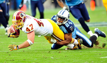 NASHVILLE, TN - NOVEMBER 21:  Chris Hope #24 of the Tennessee Titans tackles Chris Cooley #47 of the Washington Redskins at LP Field on November 21, 2010 in Nashville, Tennessee. The Redskins won 19-16 in overtime.  (Photo by Grant Halverson/Getty Images)