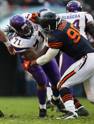 CHICAGO - NOVEMBER 14: Phil Loadholt #71 of the Minnesota Vikings tries to block Julius Peppers #90 of the Chicago Bears at Soldier Field on November 14, 2010 in Chicago, Illinois. The Bears defeated the Vikings 27-13. (Photo by Jonathan Daniel/Getty Imag