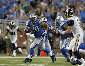 DETROIT - OCTOBER 10: Ndamukong Suh #90 of the Detroit Lions intercepts the ball and runs it back during the fourth quarter of the game against the St. Louis Rams at Ford Field on October 10, 2010 in Detroit, Michigan.  The Lions defeated the Rams 44-6.