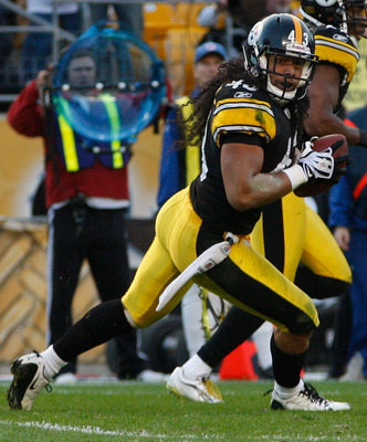 PITTSBURGH - NOVEMBER 21:  Troy Polamalu #43 of the Pittsburgh Steelers runs with the ball after catching an interception against the Oakland Raiders during the game on November 21, 2010 at Heinz Field in Pittsburgh, Pennsylvania.  (Photo by Jared Wickerh