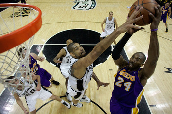 SAN ANTONIO - MAY 27:  Tim Duncan #21 of the San Antonio Spurs goes to block the shot of Kobe Bryant #24 of the Los Angeles Lakers in Game Four of the Western Conference Finals during the 2008 NBA Playoffs on May 27, 2008 at the AT&T Center in San Antonio
