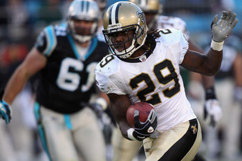 CHARLOTTE, NC - NOVEMBER 07:  Chris Ivory #29 of the New Orleans Saints runs with the ball against the Carolina Panthers during their game at Bank of America Stadium on November 7, 2010 in Charlotte, North Carolina.  (Photo by Streeter Lecka/Getty Images)