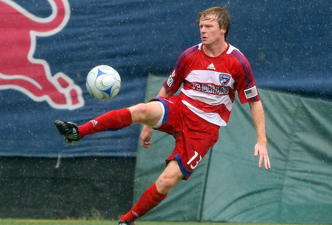 EAST RUTHERFORD, NJ - AUGUST 23:  Dax McCarty #13 of the FC Dallas plays the ball against the New York Red Bulls at Giants Stadium in the Meadowlands on August 23, 2009 in East Rutherford, New Jersey.  (Photo by Mike Stobe/Getty Images for New York Red Bu