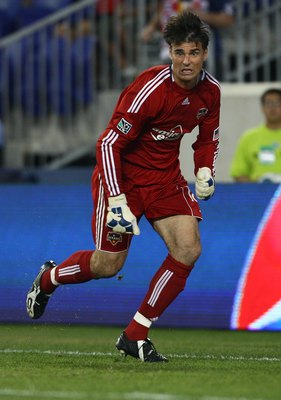 HARRISON, NJ - JUNE 02:  Pat Onstad #18 of the Houston Dynamo defends against the New York Red Bulls on June 2, 2010 at Red Bull Arena in Harrison, New Jersey. Red Bulls defeat the Dynamo 2-1.  (Photo by Mike Stobe/Getty Images for New York Red Bulls)