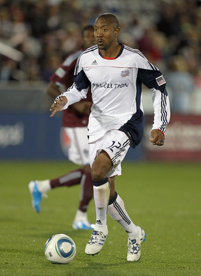 COMMERCE CITY, CO - SEPTEMBER 18:  Cory Gibbs #12 of the New England Revolution controls the ball against the Colorado Rapids at Dick's Sporting Goods Park on September 18, 2010 in Commerce City, Colorado. The Rapids defeated the Revolution 3-0.  (Photo b