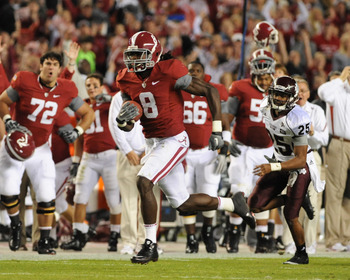TUSCALOOSA, AL - NOVEMBER 13: Wide receiver Julio Jones #8 of the Alabama Crimson Tide runs 56 yards with a touchdown pass against the Mississippi State Bulldogs November 13, 2010 at Bryant-Denny Stadium in Tuscaloosa, Alabama.  (Photo by Al Messerschmidt