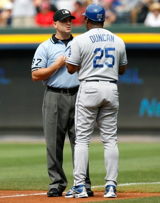 ATLANTA - AUGUST 01:  First base coach Mariano Duncan #25 of the Los Angeles Dodgers argues a call with umpire Scott Barry against the Atlanta Braves on August 1, 2009 at Turner Field in Atlanta, Georgia.  (Photo by Kevin C. Cox/Getty Images)