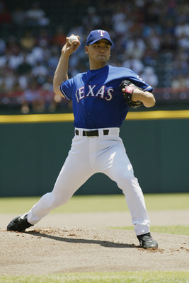 ARLINGTON-JUNE 2:  Chan Ho Park #61 of the Texas Rangers pitches the ball during the game against the Kansas City Royals  at The Ballpark in Arlington, Texas on June 2, 2002. The Rangers won 8-6. (Photo by Ronald Martinez/Getty Images)