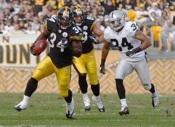 PITTSBURGH - NOVEMBER 21:  Rashard Mendenhall #34 of the Pittsburgh Steelers runs by Mike Mitchell #34 of the Oakland Raiders during the game on November 21, 2010 at Heinz Field in Pittsburgh, Pennsylvania.  (Photo by Jared Wickerham/Getty Images)