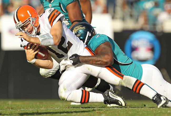 JACKSONVILLE, FL - NOVEMBER 21:  Colt McCoy #12  of the Cleveland Browns is sacked by Larry Hart #59  during a game agaisnt the Jacksonville Jaguars at EverBank Field on November 21, 2010 in Jacksonville, Florida.  (Photo by Mike Ehrmann/Getty Images)