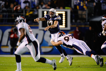 SAN DIEGO - NOVEMBER 22:  Quarterback Philip Rivers #17 of the San Diego Chargers throws an incomplete pass under pressure from Justin Bannan #27 of the Denver Broncos at Qualcomm Stadium on November 22, 2010 in San Diego, California.  (Photo by Kevork Dj