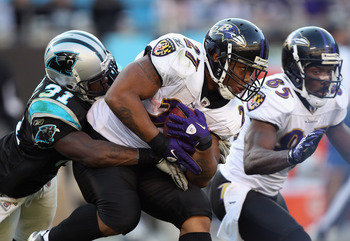 CHARLOTTE, NC - NOVEMBER 21:  Ray Rice #27 of the Baltimore Ravens is tackled by Richard Marshall #31 of the Carolina Panthers at Bank of America Stadium on November 21, 2010 in Charlotte, North Carolina.  (Photo by Streeter Lecka/Getty Images)