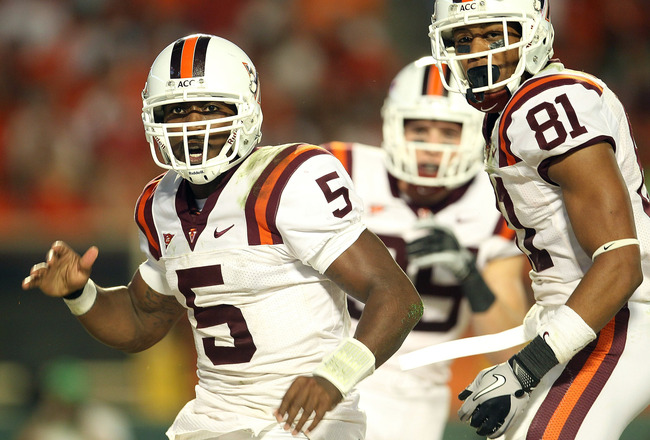 MIAMI - NOVEMBER 20:  Tyrod Taylor #5 of the Virginia Tech Hokies celebrates with teammate Jarrett Boykin #81 after rushing for a touchdown during a game against the Miami Hurricanes at Sun Life Stadium on November 20, 2010 in Miami, Florida.  (Photo by M