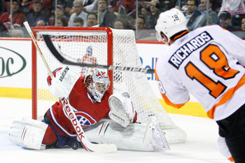 MONTREAL- NOVEMBER 16:  Carey Price #31 of the Montreal Canadiens stops the puck on a shot by Mike Richards #18 of the Philadelphia Flyers during the NHL game at the Bell Centre on November 16, 2010 in Montreal, Quebec, Canada.  (Photo by Richard Wolowicz