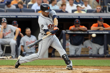 NEW YORK - AUGUST 16:  Ryan Raburn #25 of the Detroit Tigers connects on a second inning two run home run against the New York Yankees on August 16, 2010 at Yankee Stadium in the Bronx borough of New York City.  (Photo by Jim McIsaac/Getty Images)