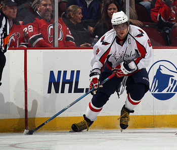 NEWARK, NJ - NOVEMBER 22:  Alex Ovechkin #8 of the Washington Capitals skates against the New Jersey Devils at the Prudential Center on November 22, 2010 in Newark, New Jersey. The Devils defeated the Capitals 5-0.  (Photo by Bruce Bennett/Getty Images)