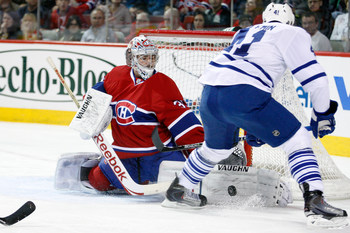 MONTREAL - NOVEMBER 20:  Carey Price #31 of the Montreal Canadiens stops the puck on shot by Nikolai Kulemin #41 of the Toronto Maple Leafs during the NHL game at the Bell Centre on November 20, 2010 in Montreal, Quebec, Canada.  (Photo by Richard Wolowic