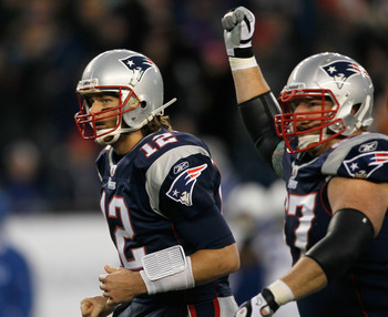 FOXBORO, MA - NOVEMBER 21: Tom Brady #12 of the New England Patriots reacts with teammate Dan Koppen #67 of the New England Patriots after a touchdown in the first half at Gillette Stadium on November 21, 2010 in Foxboro, Massachusetts. (Photo by Jim Roga