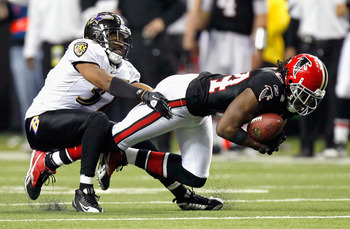 ATLANTA - NOVEMBER 11:  Roddy White #84 of the Atlanta Falcons dives for more yardage against Josh Wilson #37 of the Baltimore Ravens at Georgia Dome on November 11, 2010 in Atlanta, Georgia.  (Photo by Kevin C. Cox/Getty Images)