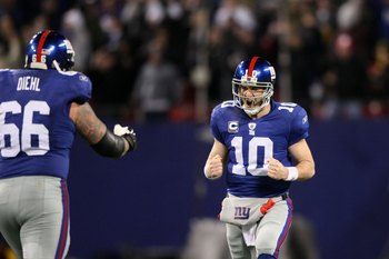 EAST RUTHERFORD, NJ - DECEMBER 13:  Eli Manning #10 of the New York Giants (R) reacts with teammate David Diehl during the game against the Philadelphia Eagles of the New York Giants at Giants Stadium on December 13, 2009 in East Rutherford, New Jersey.