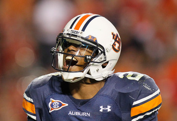 AUBURN, AL - NOVEMBER 13:  Quarterback Cameron Newton #2 of the Auburn Tigers celebrates after a touchdown against the Georgia Bulldogs at Jordan-Hare Stadium on November 13, 2010 in Auburn, Alabama.  (Photo by Kevin C. Cox/Getty Images)