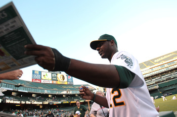 OAKLAND, CA - SEPTEMBER 24:  Chris Carter #22 of the Oakland Athletics signs autographs before a game against the Texas Rangers during a Major League Baseball game at the Oakland-Alameda County Coliseum on September 24, 2010 in Oakland, California. (Photo