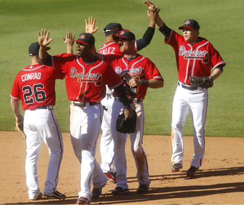 ATLANTA - OCTOBER 3:  (L-R) Teammates Brooks Conrad #26, Jason Heyward #22, Alex Gonzalez #2, Rick Ankiel #28 and Nate McLouth #24 of the Atlanta Braves celebrate the last out after the game against the Philadelphia Phillies at Turner Field on October 3,