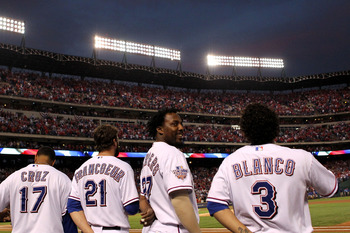 ARLINGTON, TX - NOVEMBER 01:  (L-R) Nelson Cruz #17, Jeff Francoeur #21, Vladimir Guerrero #27 and Elvis Andrus #1 of the Texas Rangers stand for the performance of the National Anthem against the San Francisco Giants in Game Five of the 2010 MLB World Se