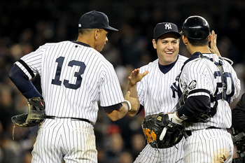 NEW YORK - OCTOBER 20:  Alex Rodriguez #13, Lance Berkman #17 and Jorge Posada #20 of the New York Yankees celebrate after the Yankees won 7-2 against the Texas Rangers in Game Five of the ALCS during the 2010 MLB Playoffs at Yankee Stadium on October 20,