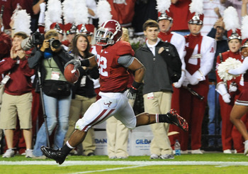 TUSCALOOSA, AL - NOVEMBER 13: Running back Mark Ingram #22 of the Alabama Crimson Tide runs 78 yards with a pass for a second-quarter touchdown against the Mississippi State Bulldogs November 13, 2010 at Bryant-Denny Stadium in Tuscaloosa, Alabama.  (Phot