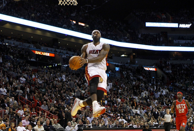 MIAMI - NOVEMBER 06: Forward LeBron James #6  of the Miami Heat dunks against the New Jersey Nets  at American Airlines Arena on November 6, 2010 in Miami, Florida. NOTE TO USER: User expressly acknowledges and agrees that, by downloading and or using thi