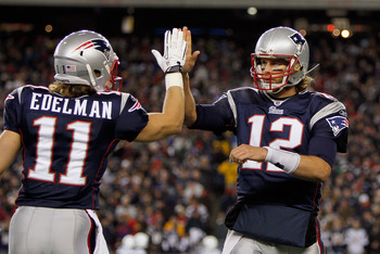 FOXBORO, MA - NOVEMBER 21: Tom Brady #12 of the New England Patriots reacts with teammate Julian Edelman #11 after a touchdown in the second half at Gillette Stadium on November 21, 2010 in Foxboro, Massachusetts. (Photo by Jim Rogash/Getty Images)