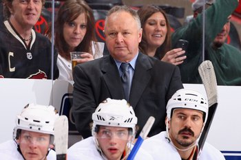 GLENDALE, AZ - DECEMBER 23:  Head coach Randy Carlyle of the Anaheim Ducks looks on from the bench during the NHL game against the Phoenix Coyotes at Jobing.com Arena on December 23, 2009 in Glendale, Arizona. The Coyotes defeated the Ducks 4-0.  (Photo b