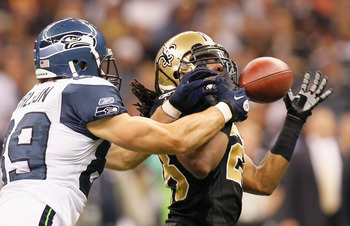 NEW ORLEANS - NOVEMBER 21:  Usama Young #28 of the New Orleans Saints nearly picks off a pass intended for John Carlson #89 of the Seattle Seahawks at Louisiana Superdome on November 21, 2010 in New Orleans, Louisiana.  (Photo by Kevin C. Cox/Getty Images