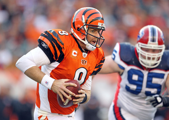 CINCINNATI - NOVEMBER 21:  Carson Palmer #9 of the Cincinnati Bengals runs with the ball during the Bengals 49-31 loss to the Buffalo Bills at Paul Brown Stadium on November 21, 2010 in Cincinnati, Ohio.  (Photo by Andy Lyons/Getty Images)